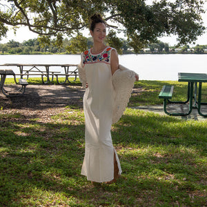 Mexican long white dress, multicolor embroidery, on a lake