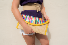 Palm woven clutch bag embroidered with sequin, lines, yellow trim
