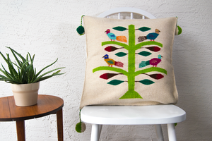 Bohemian accent pillow made on loom, colorful design birds on a tree