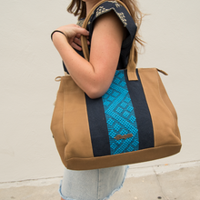 Leather bag, camel color, navy and blue loom insert, modeled