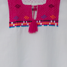 White Mexican huipil embroidered with pink yarn