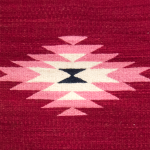 Wool accent pillow made on loom, red and pink geometric diamond