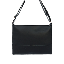 black leather bag, back view
