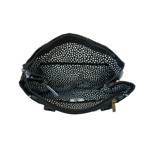 Black and blue leather bag with loom insert, interior.