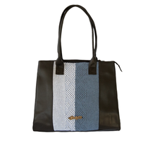 Black and blue leather bag with loom insert.