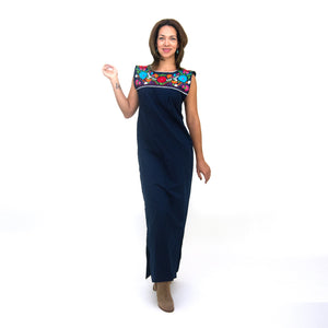 Mexican long blue dress, multicolor floral embroidery, modeled