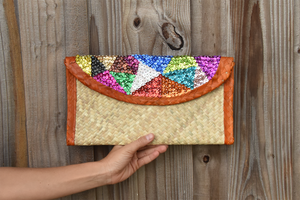 palm woven clutch bag embroidered with sequin, triangles, orange trim
