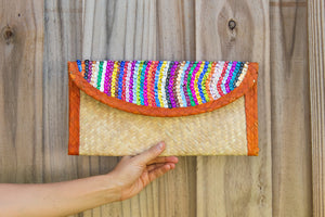 Palm woven clutch bag embroidered with sequin, lines, orange trim