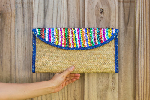 Palm woven clutch bag embroidered with sequin, lines, blue trim