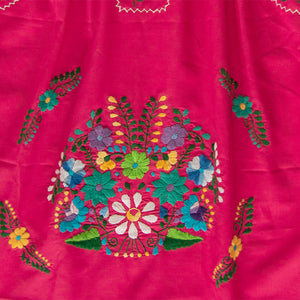 Pink and multicolor Mexican embroidery from dress