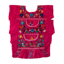 Pink and multicolor Mexican embroidered dresses.