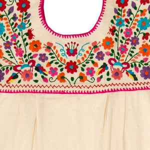 multicolor embroidery of white Mexican dress