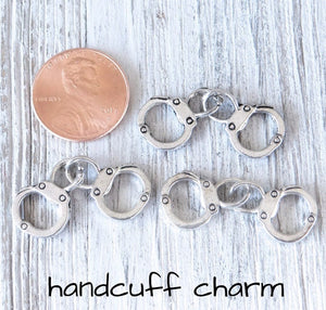 12 pc Handcuff charm, hand cuffs, hand cuffs charm. Alloy charm, very high quality.Perfect for jewery making and other DIY projects