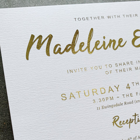 Linen wedding invitation with gold foil