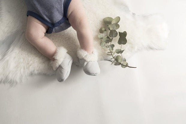 top view of Natures Fleece silken wool rug and baby with booties combo