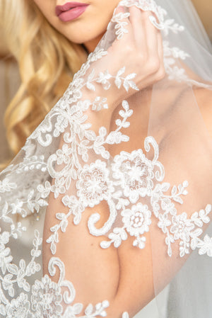 Timeless Wedding Veils Closeup of Bettina alencon lace on chapel veil