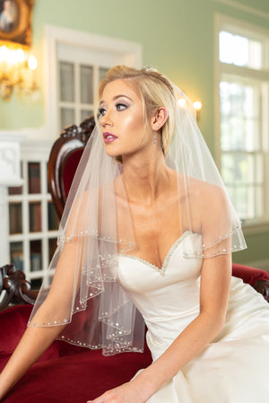 Isabel  A two layer elbow veil with silver beaded pencil edge