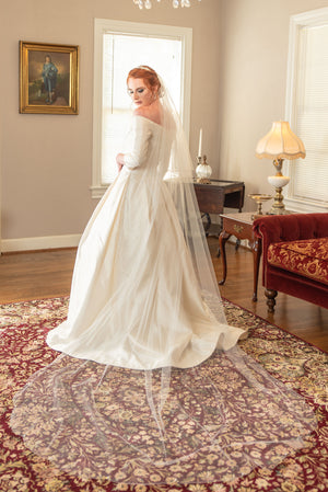 Jayne  A two layer chapel veil with beaded scalloped rolled edge