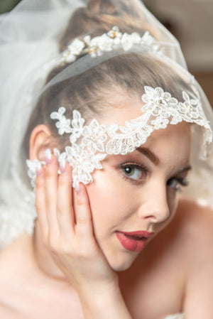 Jeanne  A two layer beaded alencon lace fingertip veil