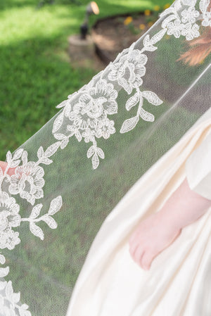Timeless Wedding Veils Closeup of leafy alencon lace on cathedral veil