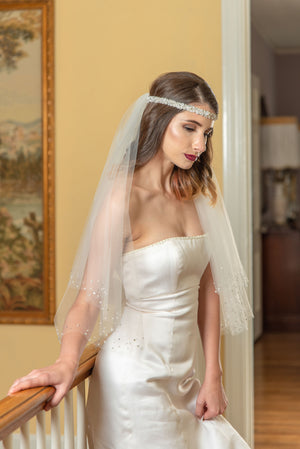 Odile  A two tier elbow veil with scattered crystal edge