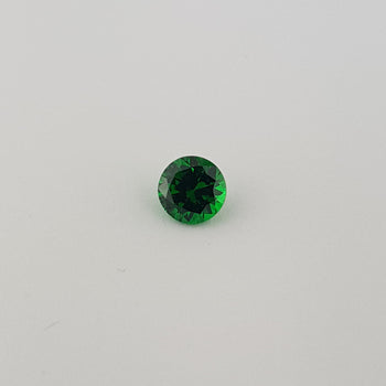 0.69ct Round Faceted Demantoid Garnet 5.2mm