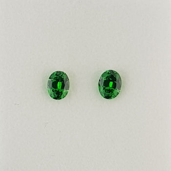 0.77ct Pair of Oval Faceted Demantoid Garnets 4x5mm