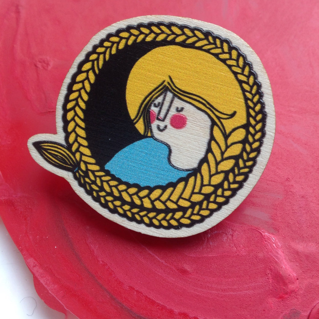 The girl with the plaited hair pin badge