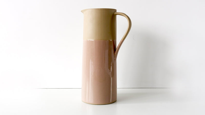 tall slip cast porcelain pitcher or vase