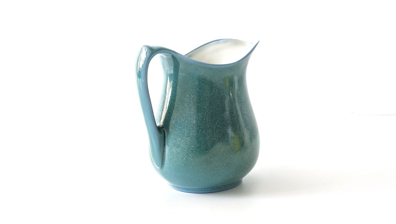 classic curvy slip cast copper oxide green glazed porcelain jug