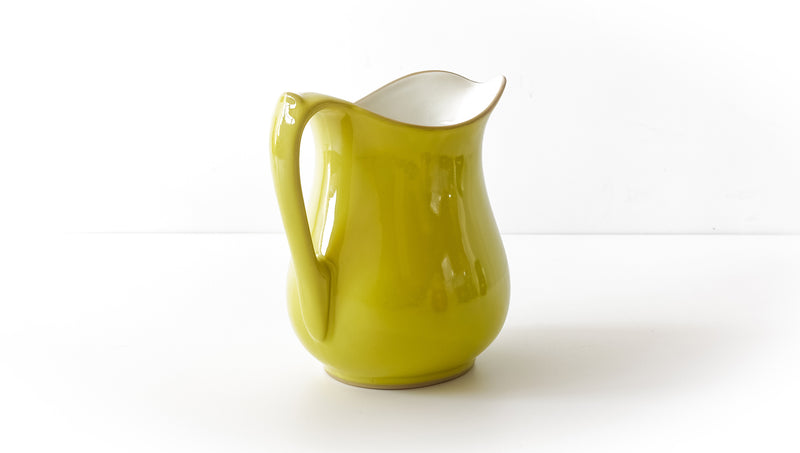 classic curvy slip cast yellow glazed porcelain jug