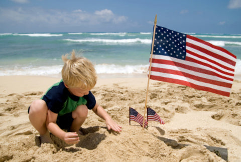 Kids play at beach on Labor Day Weekend - enjoy the end of summer