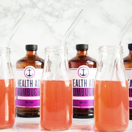 Maca-Berry Kombucha and Full glasses of Health-Ade Kombucha