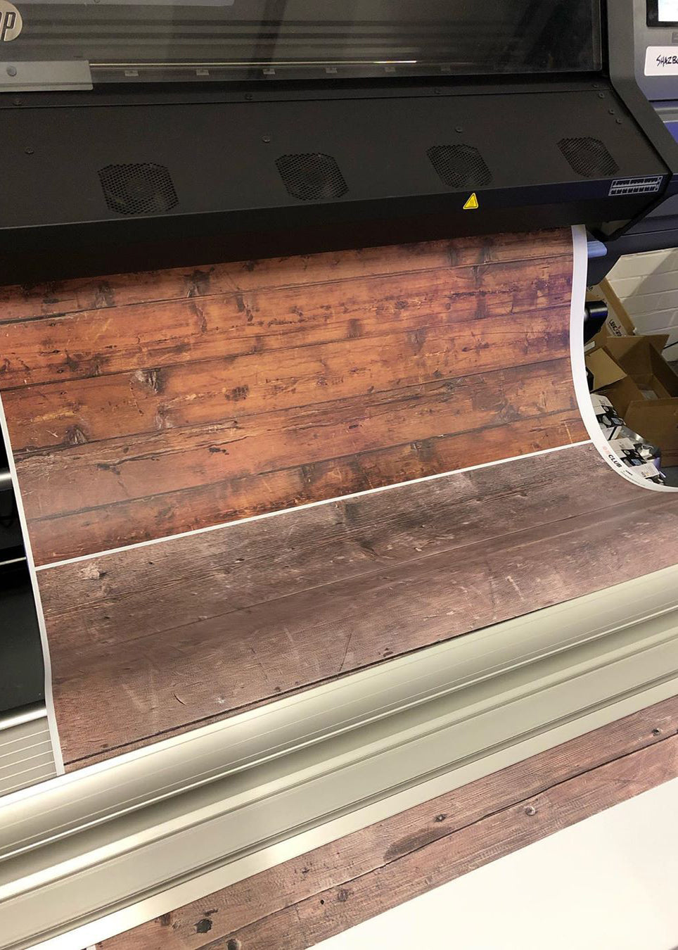 Wood textures printing onto vinyl at Club Backdrops