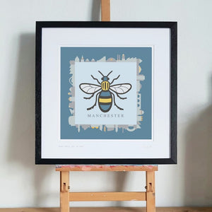 Manchester Bee and Skyline Framed Print by S L Scott