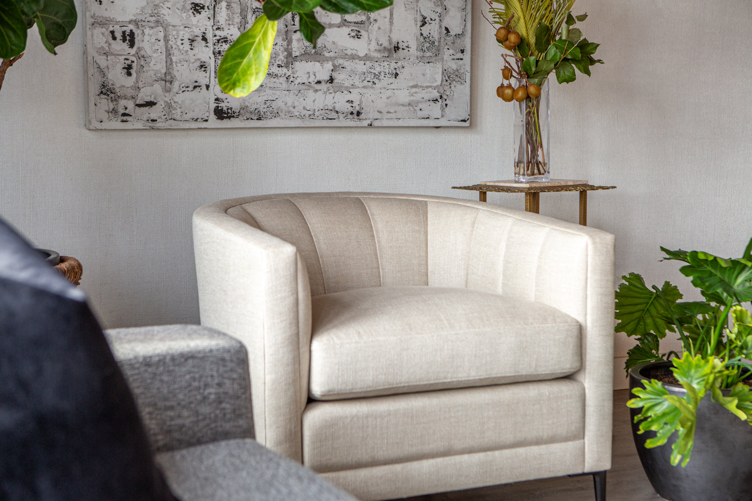 Close up view within a room scene of the Coco Chair by ffabb home upholstered in Linen- Oatmeal