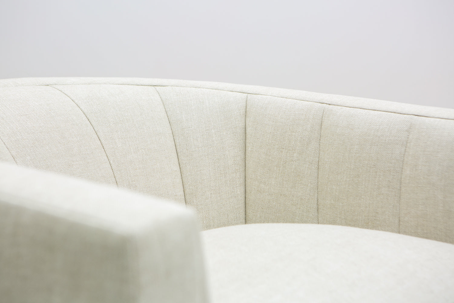 Extreme close up of the channeled inside back of the Coco Chair by ffabb home upholstered in Linen-Oatmeal