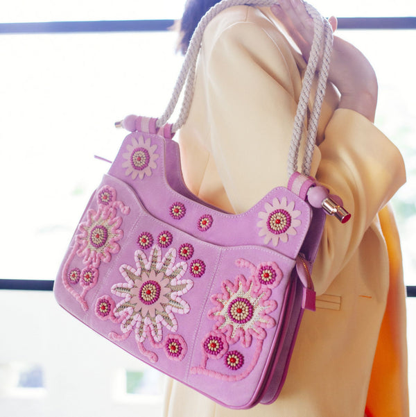 Pink,  canvas, boston bag: embellished with handmade  embroidery with pink and  white flowers. Comes with a rope handle.