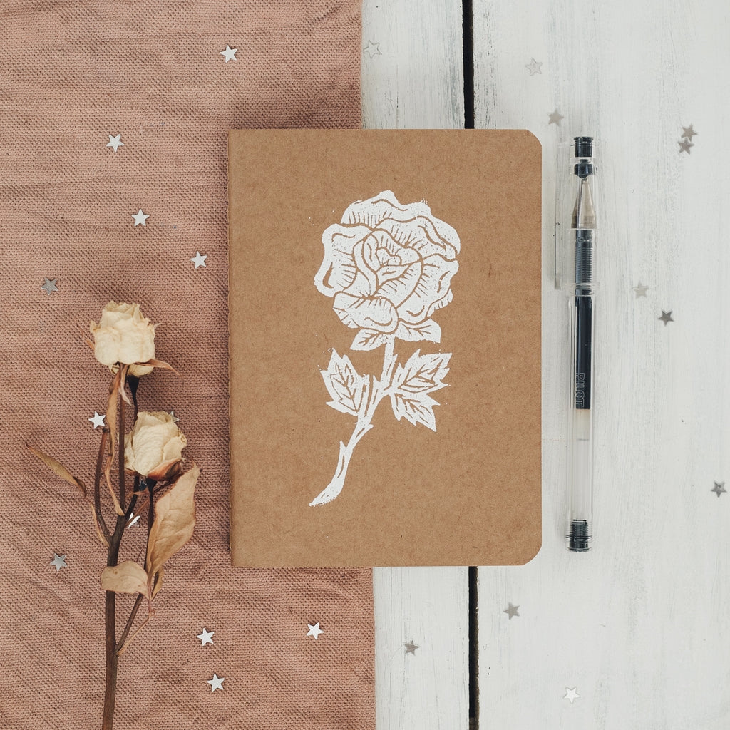 rose notebook in white