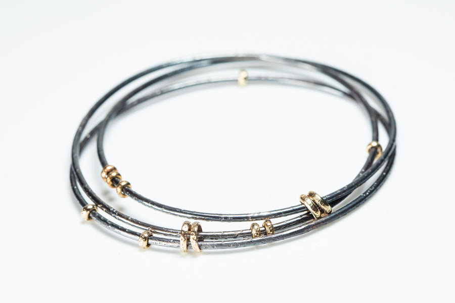 Interlocking Sterling and Gold Bangle