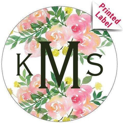 Initials monogram with a pretty floral background label on custom blue wine bottle by Etching Expressions