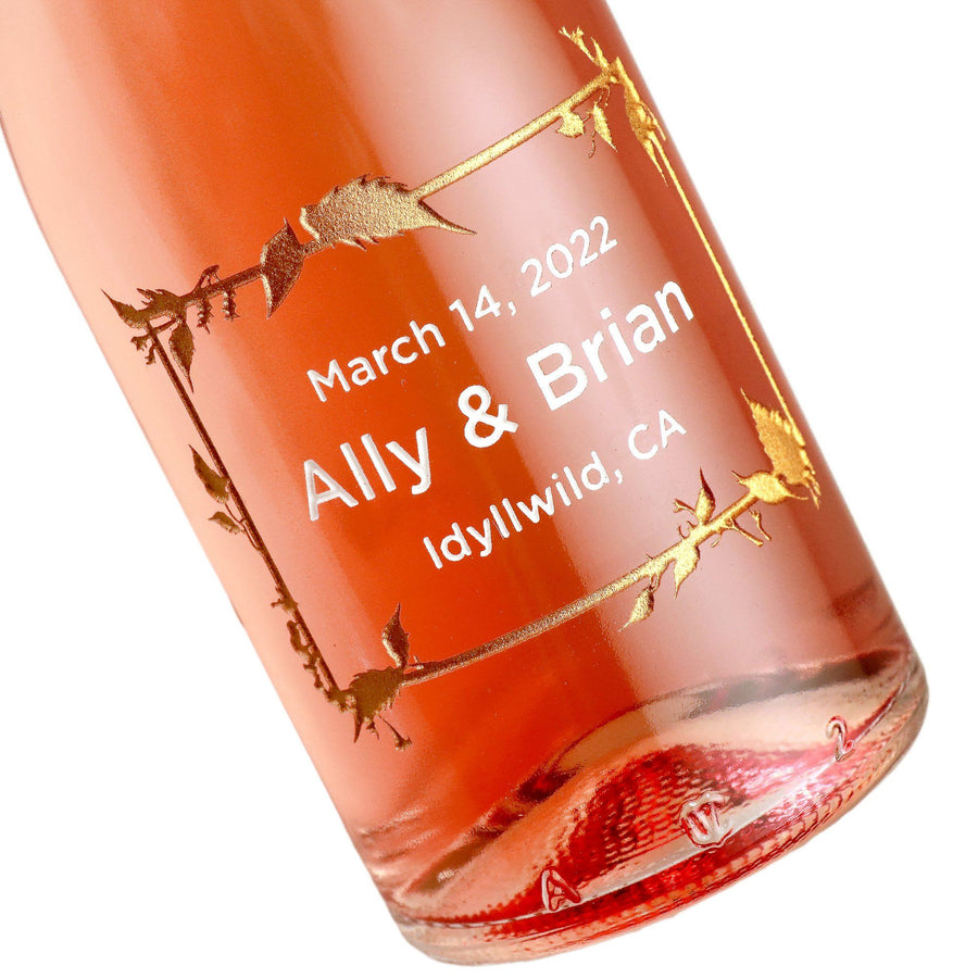 Engraved wedding rose wine favors with a floral frame design by Etching Expressions