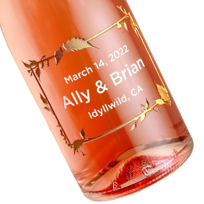 Case of etched mini rose wine wedding favors with floral frame design by Etching Expressions