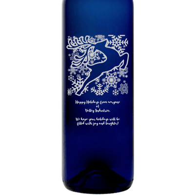 Holiday Reindeer design on a custom blue wine bottle by Etching Expressions