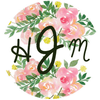 Initials monogram with a pink and green flower background label on blue wine bottle by Etching Expressions