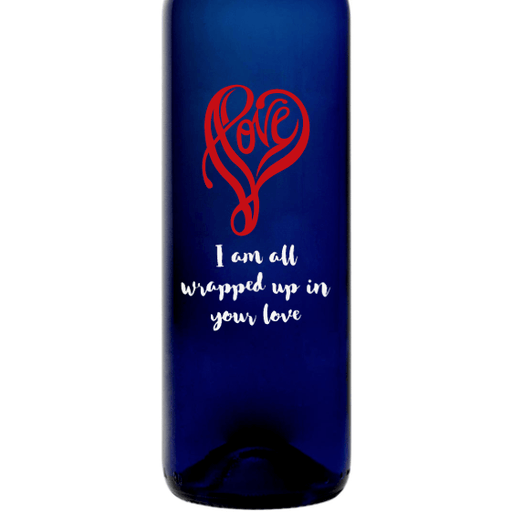 Love written in a heart shape personalized blue wine bottle by Etching Expressions