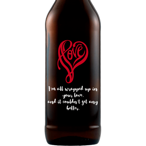 Love written in a heart shape custom beer bottle by Etching Expressions