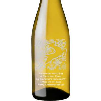 Holiday Reindeer design on a custom white wine bottle by Etching Expressions