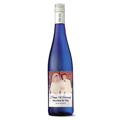 Custom uploaded photo printed label on blue wine bottle by Etching Expressions