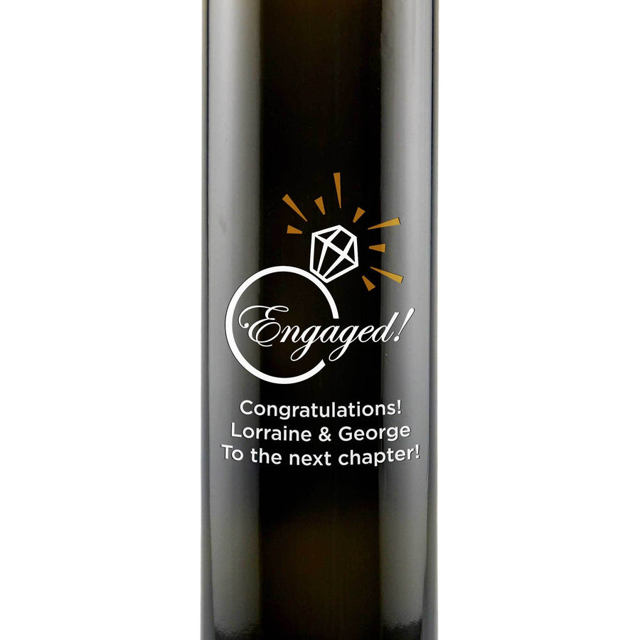 Engaged! with a diamond graphic etched on an olive oil bottle engagement gift by Etching Expressions